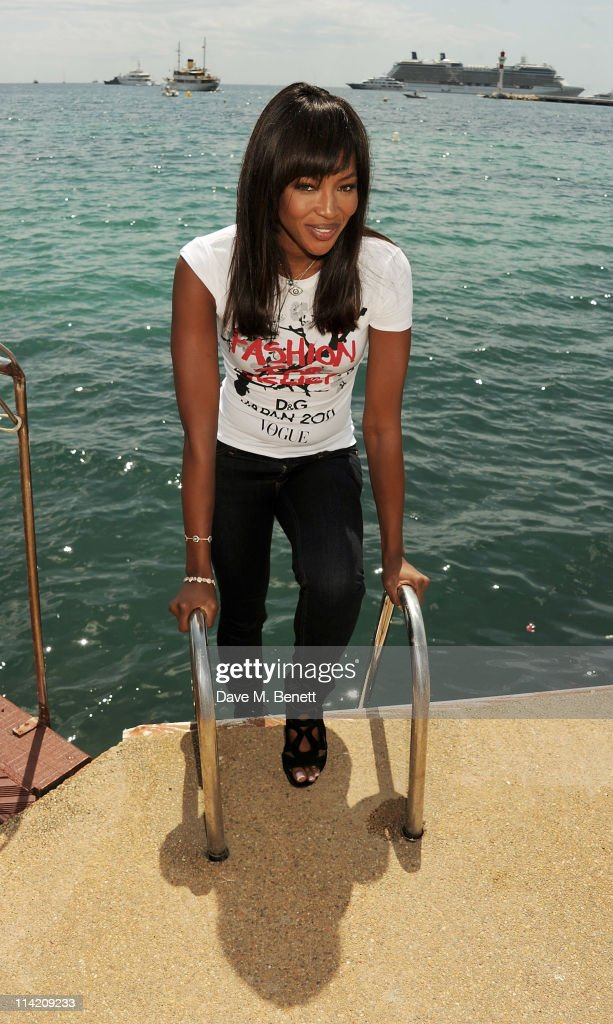 Model Naomi Campbell poses during a photocall for her charity Fashion For Relief at the Majestic Beach Pier on May 15, 2011 in Cannes, France.