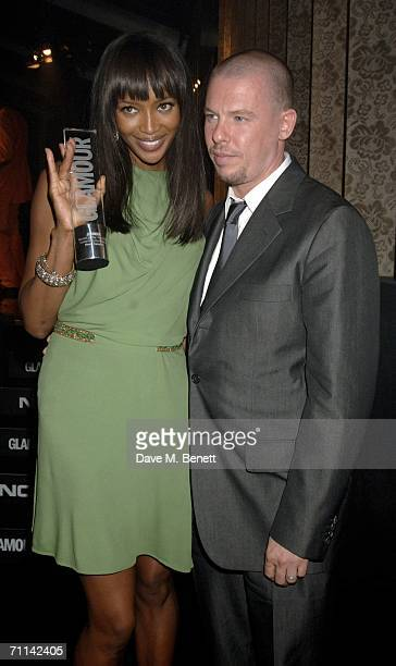 Model Naomi Campbell poses with the award for Outstanding Contribution presented by Alexander McQueen at the Glamour Women Of The Year Awards the...