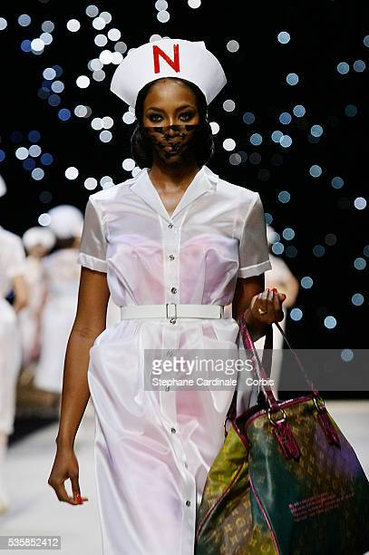 Model Naomi Campbell presents a creation from the Louis Vuitton Spring/Summer 2008 collection during Paris Fashion Week.