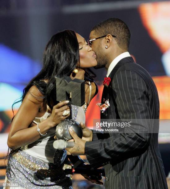Model Naomi Campbell presents rapper Usher with the award for Best Male during the MTV Europe Music Awards 2004 at Tor di Valle November 18 2004 in...