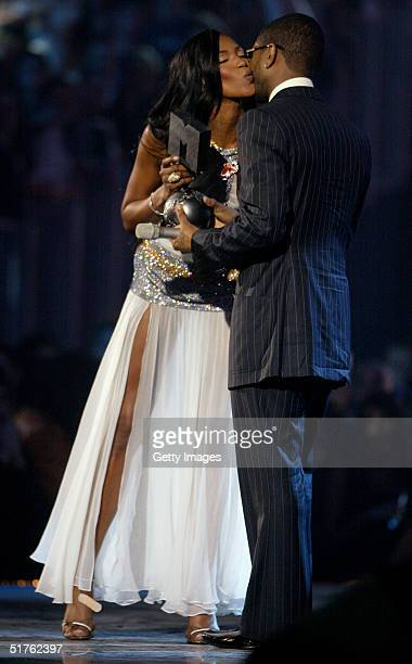 Model Naomi Campbell presents rapper Usher with the Best Male award during the MTV Europe Music Awards 2004 at Tor di Valle November 18 2004 in Rome...