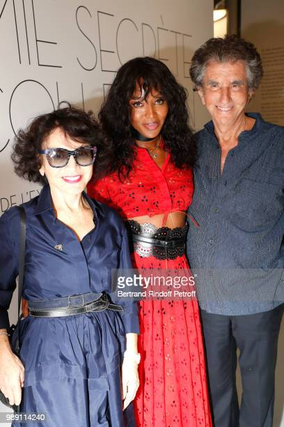 Model Naomi Campbell standing between Jack lang and his wife Monique attend L'Alchimie secrete d'une collection The Secret Alchemy of a Collection...