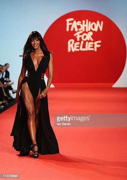 Model Naomi Campbell walks the runway at Fashion For Relief at Forville market during the 64th Annual Cannes Film Festival on May 16 2011 in Cannes...