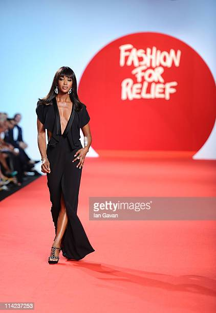 Model Naomi Campbell walks the runway at the Fashion For Relief at Forville market during the 64th Annual Cannes Film Festival on May 16, 2011 in...