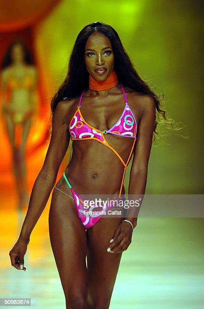 Model Naomi Campbell walks the runway at the Sao Paulo Fashion Week Summer 2004/2005 Rosa Cha Fashion Show at the Fundacao Bienal de Sao Paulo during...
