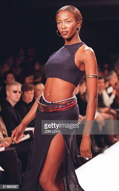 Model Naomi Campbell wears a navy knit sleeveless minitop over a matching slit skirt during Ralph Lauren's Spring 1996 fashion collection 30 October...