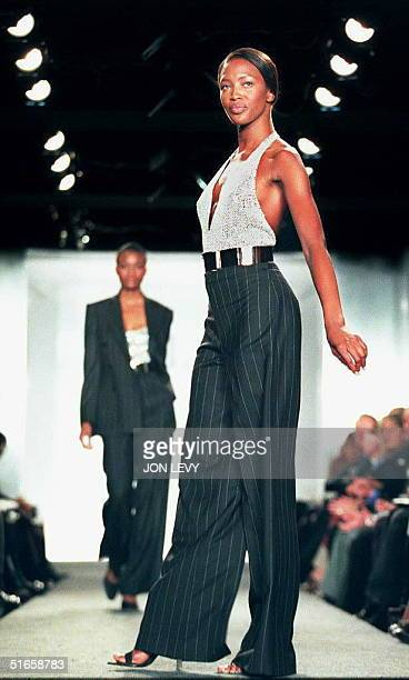 Model Naomi Campbell wears a sparkling backless top over pinstripe pants in the Ralph Lauren Fall 1997 Collection 09 April in New York Over 50...