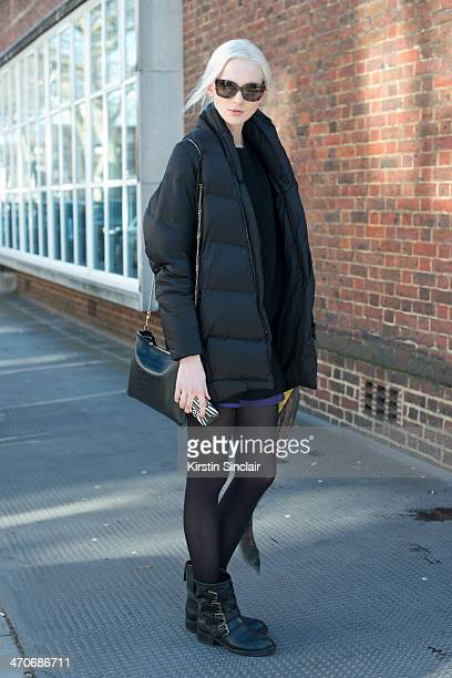 Model Nastya Kusakina wears a Whistles bag Marc Jacobs shoes All Saints sweater and Prada sunglasses on day 3 of London Collections Women on February...