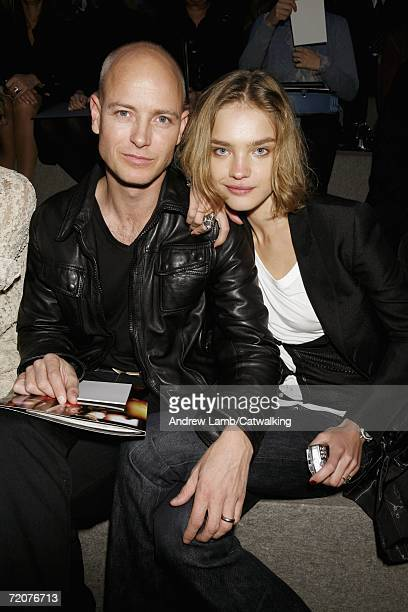 Model Natalia Vodianova and husband Justin Portman sit in the audience during the Christian Dior Fashion Show as part of Paris Fashion Week...
