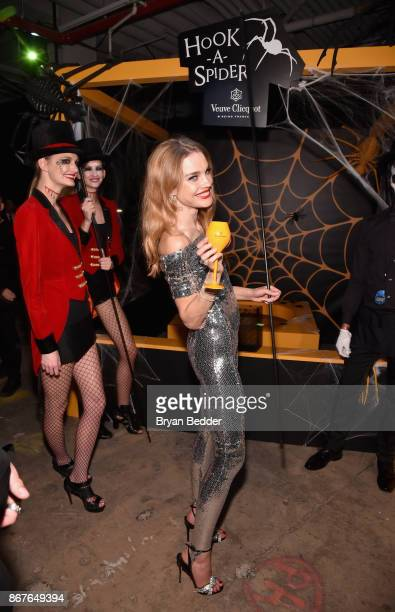 Model Natalia Vodianova attends Moet Hennessy at The 2017 amfAR and The Naked Heart Foundation Fabulous Fund Fair on October 28 2017 in New York City