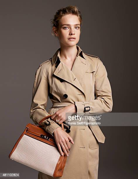 Model Natalia Vodianova is photographed for Madame Figaro on April 13 2015 in Paris France Trench Kelly bag personal ring Makeup by Guerlain...