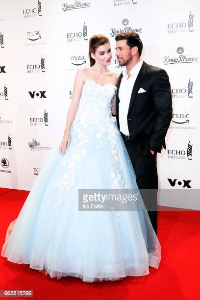 Model natalie Volk and TV Bachelor Leonard Freier during the Echo award red carpet on April 6 2017 in Berlin Germany