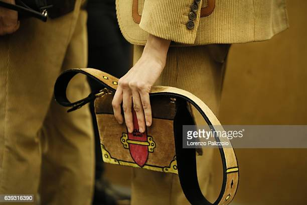 Model Natalie Westling bag detail is seen backstage ahead of the Prada show during Milan Men's Fashion Week Fall/Winter 2017/18 on January 15 2017 in...