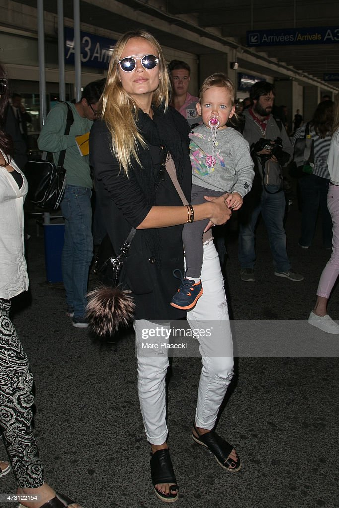 Model Natasha Poly and her baby daughter Aleksandra are seen at Nice airport during the 68th annual Cannes Film Festival on May 13, 2015 in Cannes, France.