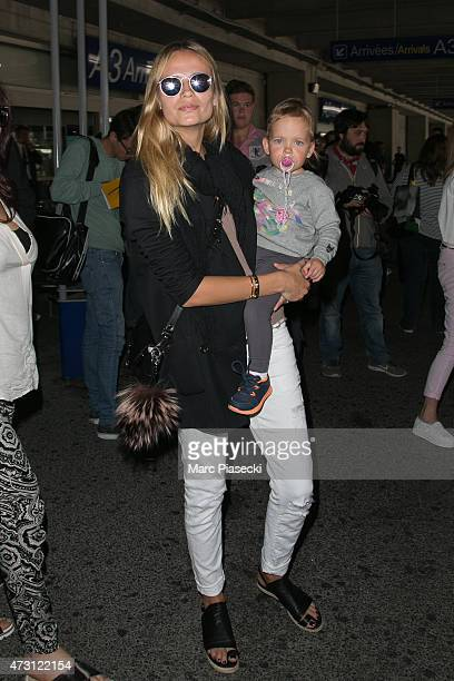 Model Natasha Poly and her baby daughter Aleksandra are seen at Nice airport during the 68th annual Cannes Film Festival on May 13 2015 in Cannes...