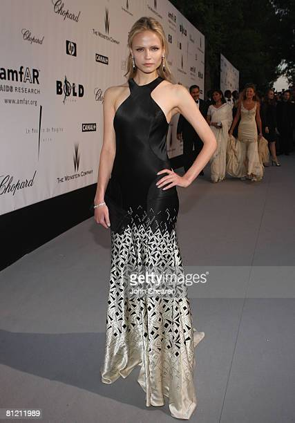 Model Natasha Poly arrives at amfAR's Cinema Against AIDS 2008 benefit held at Le Moulin de Mougins during the 61st International Cannes Film...