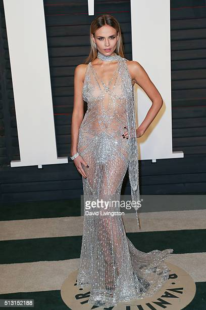Model Natasha Poly arrives at the 2016 Vanity Fair Oscar Party Hosted by Graydon Carter at the Wallis Annenberg Center for the Performing Arts on...
