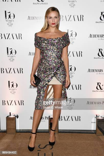 Model Natasha Poly arrives at the Harper's Bazaar Woman Of The Year Awards held at Claridges Hotel on November 2 2017 in London England