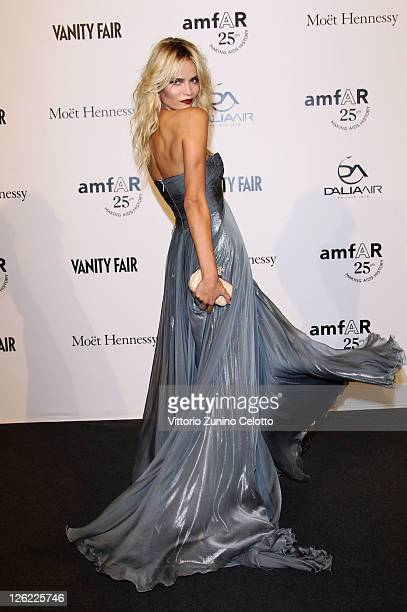 Model Natasha Poly attends amfAR MILANO 2011 at La Permanente on September 23 2011 in Milan Italy