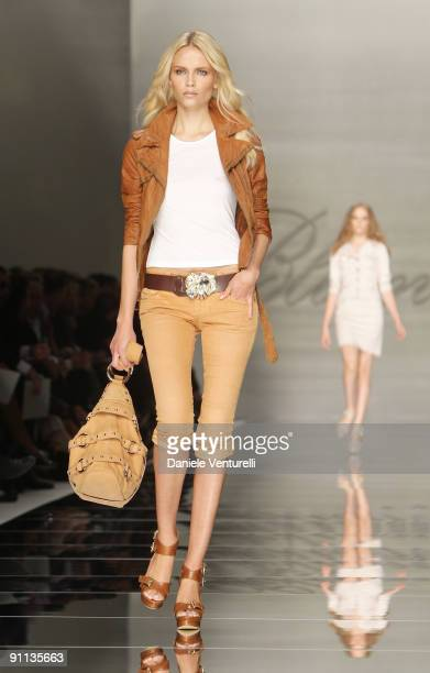 Model Natasha Poly walks down the runway during the Blumarine Milan Womenswear Fashion Week Spring/Summer 2010 at the Milano Fashion Center at on...