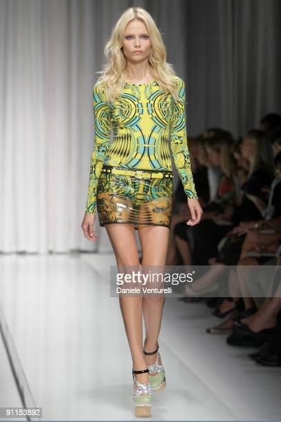 Model Natasha Poly walks down the runway during the Versace show as part of Milan Womenswear Fashion Week Spring/Summer 2010 on September 25, 2009 in...