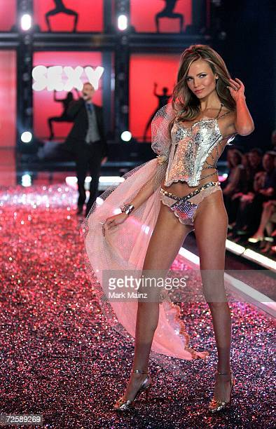 Model Natasha Poly walks the runway as singer Justin Timberlake performs during the Victoria's Secret Fashion Show held at the Kodak Theatre on...