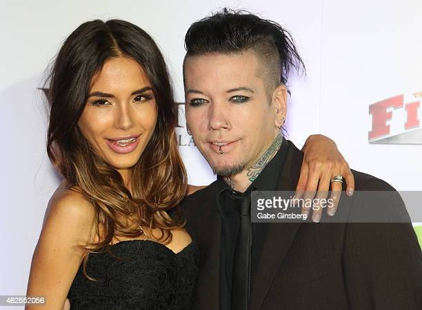 Model Nathalia Ashba and her husband guitarist Dj Ashba of Guns N' Roses and Sixx AM arrive at the seventh annual Fighters Only World Mixed Martial...