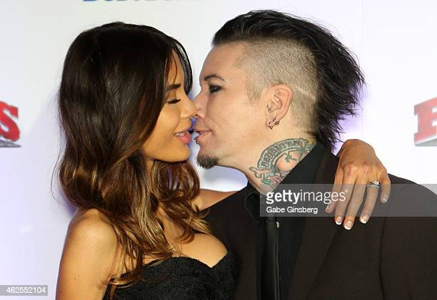 Model Nathalia Ashba and her husband guitarist Dj Ashba of Guns N' Roses and Sixx AM kiss as they arrive at the seventh annual Fighters Only World...