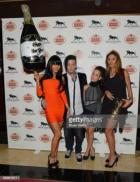 Model Nathalia Henao and guitarist Dj Ashba and guests arrive at the New Year's Eve 2014 celebration at Beacher's Madhouse Las Vegas at the MGM Grand...