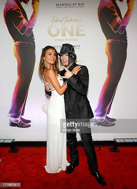 Model Nathalia Henao and guitarist Dj Ashba of Guns N' Roses arrive at the world premiere of Michael Jackson ONE by Cirque du Soleil at THEhotel at...