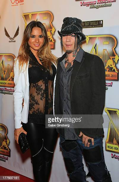 Model Nathalia Henao and guitarist Dj Ashba of Guns N' Roses arrive at the 2013 Vegas Rocks magazine music awards at The Joint inside the Hard Rock...