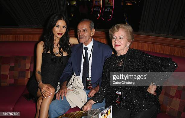 Model Nathalia Henao and her grandparents Fabio Henao and Carmen Henao attend an after party for the grand opening of guitarist Dj Ashba's Ashba...