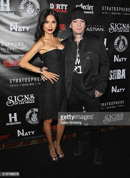 Model Nathalia Henao and her husband guitarist Dj Ashba of SixxAM attend the grand opening of their Ashba Clothing Store at the Stratosphere Casino...