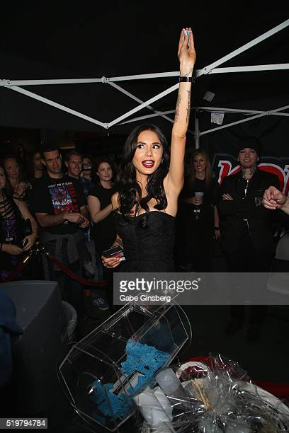 Model Nathalia Henao draws a raffle ticket during the grand opening of guitarist Dj Ashba's Ashba Clothing Store at the Stratosphere Casino Hotel on...