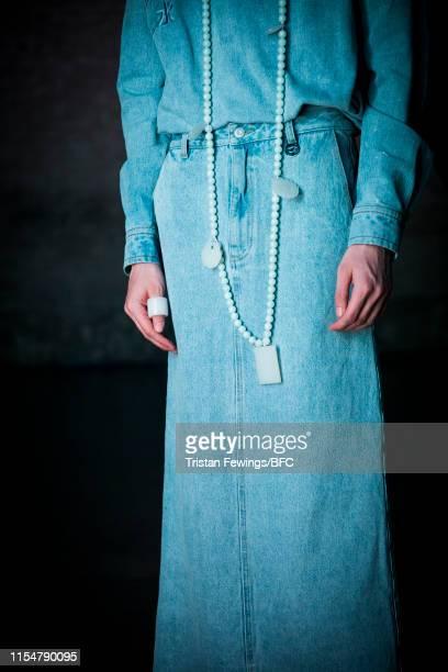 A model necklace detail at the Xander Zhou digital presentation during London Fashion Week Men's June 2019 on June 09 2019 in London England