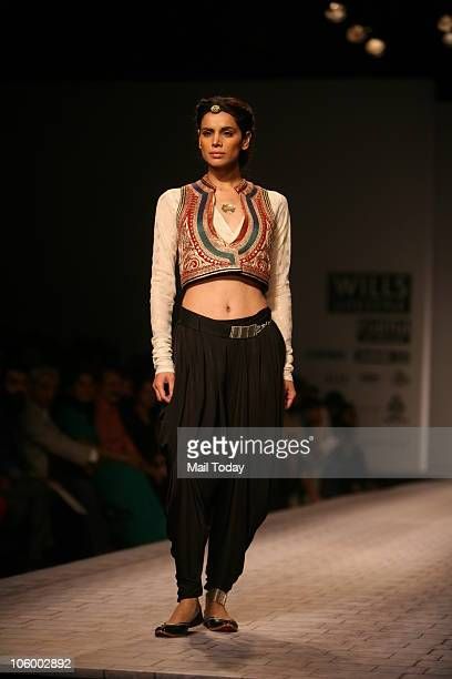 Model Neha Kapur walks the ramp for designer Anju Modi on the second day of the Wills Lifestyle India Fashion Week in New Delhi on October 24 2010
