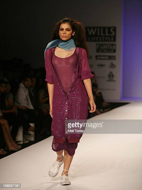 Model Neha Kapur walks the ramp for designer Chandrani Siingh Fllora on the third day of the Wills Lifestyle India Fashion Week in New Delhi on...