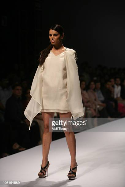 Model Neha Kapur walks the ramp for designer Vineet Bahl on the third day of the Wills Lifestyle India Fashion Week in New Delhi on October 25 2010