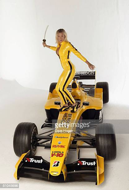 Model Nell McAndrew poses at a studio session with a Jordan F1 car ahead of this weekend's Formula One Grand Prix held on July 8 2004 at Holborn...