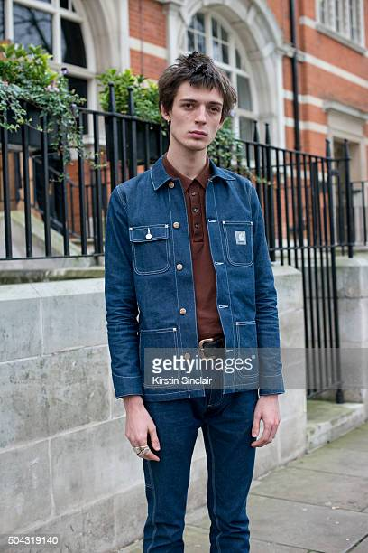 Model Niall Underwood wears a Carhartt jacket and jeans and vintage tshirt  on day 2 of 4fb91a51b37