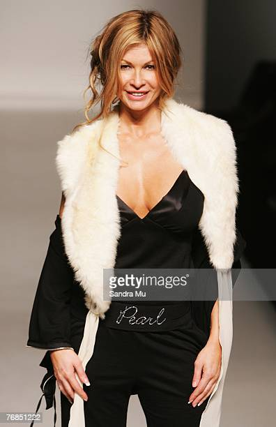 Model Nicky Watson showcases designs on the catwalk by Pearl as part of the Verging on Brilliance show on the third day of Air New Zealand Fashion...