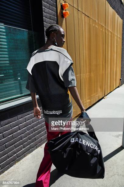 Model Nicole Atieno poses at a fashion shoot for Madame Figaro on June 19, 2017 in Paris, France. T-shirt, pants, earring and Wheel bag . PUBLISHED...