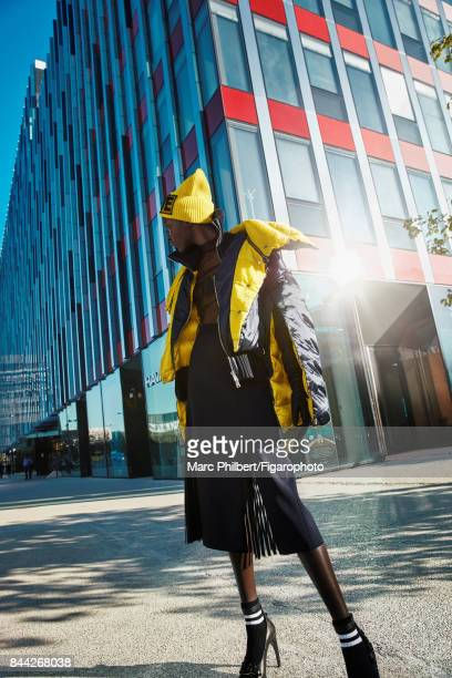 Model Nicole Atieno poses at a fashion shoot for Madame Figaro on June 19 2017 in Paris France Coat tshirt skirt hat gloves and shoes socks PUBLISHED...