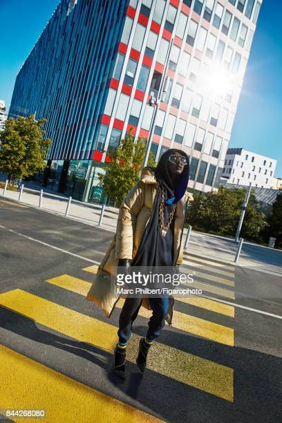 Model poses at a fashion shoot for Madame Figaro on June 19 2017 in Paris France Coat tunic and pants sunglasses necklace socks shoes PUBLISHED IMAGE...