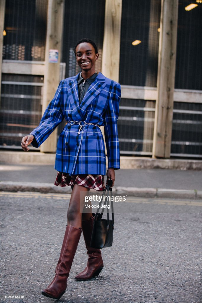7cd3b691bd3b Model Nicole Atieno wears a blue plaid blazer and brown boots after ...