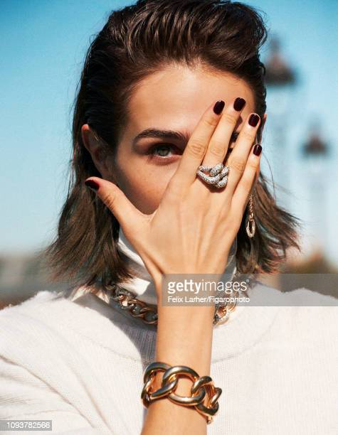 Model Nicole Neumann is photographed for Madame Figaro on October 9, 2018 in Paris, France. Necklace, bracelet, ring and earring , pullover , shirt ....