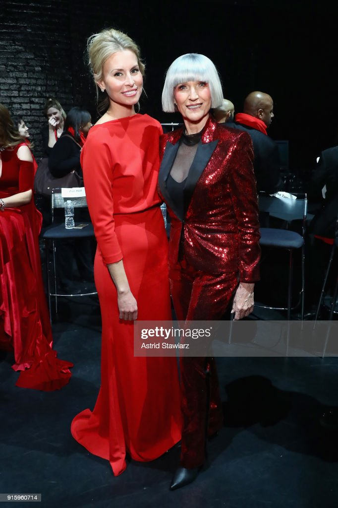 Model Niki Taylor (L) and Model Maye Musk prepares backstage at the American Heart Association's Go Red For Women Red Dress Collection 2018 presented by Macy's at Hammerstein Ballroom on February 8, 2018 in New York City.