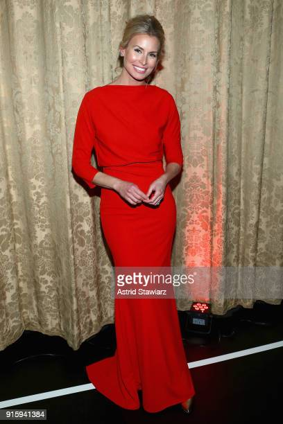 Model Niki Taylor poses backstage at the American Heart Association's Go Red For Women Red Dress Collection 2018 presented by Macy's at Hammerstein...