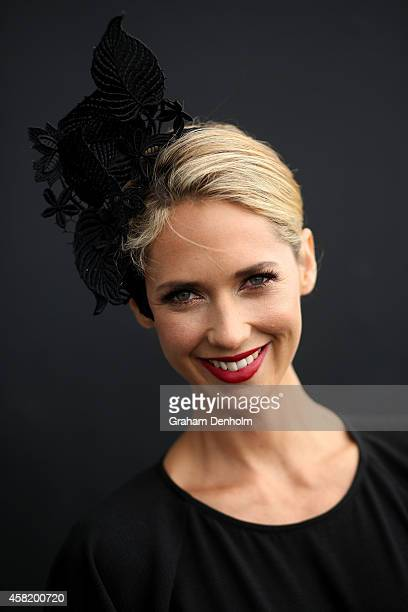 Model Nikki Phillips poses in the Fashion on the Field enclosure on Victoria Derby Day at Flemington Racecourse on November 1 2014 in Melbourne...