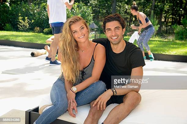 Model Nina Agdal and Akin Akman attend the Buick celebration of the new Envision in the Hamptons at Buick Studio Envision on August 12 2016 in East...